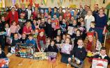 SLIDESHOW: Regeneron spreads Christmas cheer in Limerick school