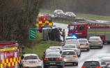 Emergency services at the scene of 'overturned vehicle' on closed Clare road