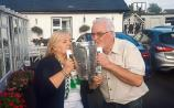 Eileen O'Riordan, mother of the late Dolores, and her son Joe kiss the Liam MacCarthy Cup after it arrives at the family home