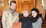 Mark O'Connor and Stefania Bardi presented a book of signatures from the Piano for Dolores event to Eileen O'Riordan after the Mass Picture: Dave Gaynor