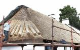 Tomás weaves his magic on Limerick pub's thatched roof