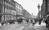 Limerick's George Street – which later became O'Connell Street – pictured sometime after 1888. The roads on the busy thoroughfare were mere dirt tracks  Pictures from the book courtesy of Sean Curtin