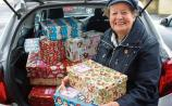 A heart of gold: Sigi Murrihy arriving at the depot in Limerick with some of the 214 shoeboxes she filled herself this year Picture: Michael Cowhey