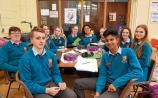 Eleven fifth year Castletroy College students wear orange mental health ambassador badges and have created a well-being self-care kit