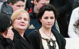 Dolores O'Riordan with her mother at her father's funeral in 2011 Picture: Press 22