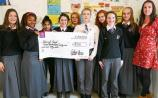 Members of the student council at Coláiste Chiaráin, Croom, with Louise Hanley, and the cheque for over €700