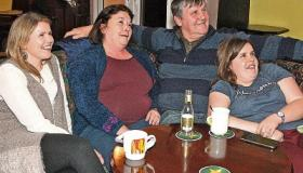 John and Joanna Griffin, Kildimo and their daughters Jennifer and Emma at the Seven Sisters Bar, Kildimo watching the new An Post advert on TV featuring their daughter Alison in Vietnam Picture: Dave