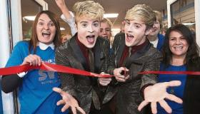 Jedward cut the ribbon on the new St Vincent de Paul shop at Roxboro Shopping Centre with store manager Tanya Fitzgerald and Ann O'Mara, SVP Picture: Dave Gaynor