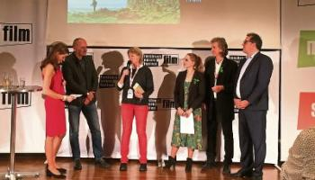 Filmmaker Katrina Costello receiving the best documentary award for The Silver Branch at The Innsbruck Film Festival