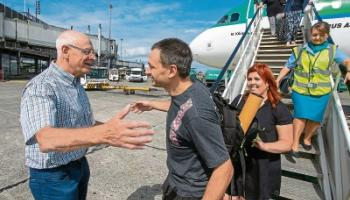 Jim Warny is greeted by family on his arrival back to Shannon Airport after taking part in the Thai cave rescue Picture: Arthur Ellis