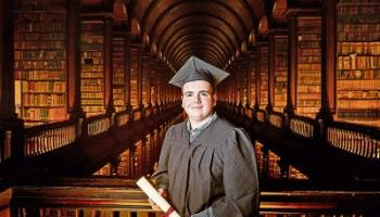 Adam O'Sullivan in the library in Trinity College after receiving his prize