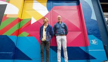 Paul O'Connell representing sponsors TLC with artist Maser, who created the urban art piece unveiled on Thomas Street last week  Picture: Alan Place