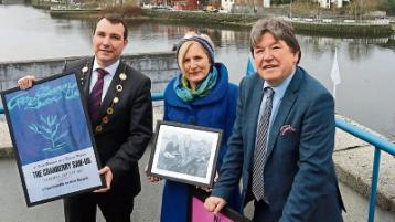 Music collector Nicky Woulfe, right, making a presentation to Mayor James Collins and Cllr Marian Hurley Picture Brendan Gleeson