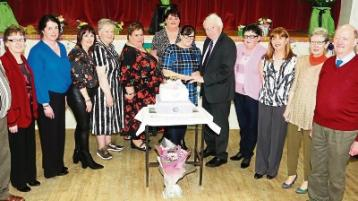 A slice of life: Josephine Ryan and Pat Fogarty cut the cake at St Michael's Day Care Centre's 20th anniversary celebrations Picture: Brendan Gleeson