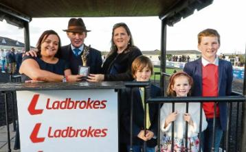 Wendy Ennis, Ladbrokes and Caroline McNamara present JP McManus' racing manager Frank Berry with the trophy, with Dylan, Olivia and Harry, children of Caroline and the late JT picture: Alain Barr
