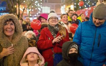 Among those smiling despite the weather was  Mirka Cholewska at the turning on of the Christmas lights in Newcastle West