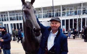 The late Johnny O'Brien pictured alongside a statue of the great horse Best Mate on a visit to Cheltenham this year