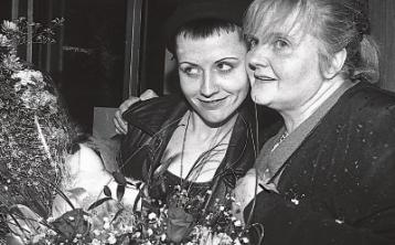 Eileen O'Riordan with her late daughter Dolores in Shannon Airport in 1991. Below, the shrine in Ballybricken church dedicated to the star Pictures: Limerick Leader