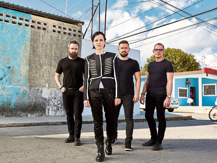Noel Hogan Mike Hogan and Fergal Lawler have paid tribute to lead singer Dolores O'Riordan who died this Monday