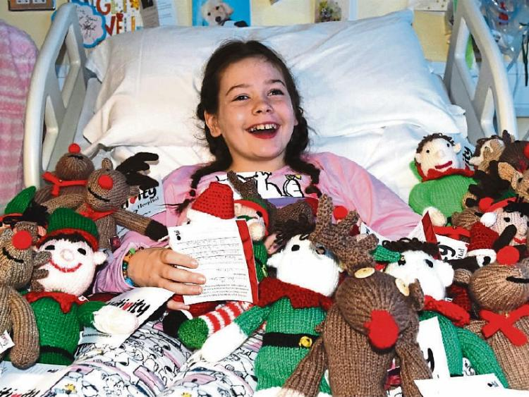Aine Ryan, from Raheen, at Beaumont hospital with the Christmas characters – Beau the Elf, Monty the Reindeer and Dr Claus – which were knitted by volunteers around the country