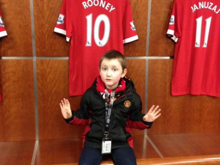 Fan: Six-year-old John Fitzgerald in the Manchester United dressing room